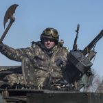 Ukrainian-soldier-holds-a-replica-of-an