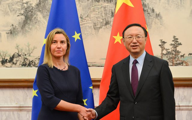 Federica Mogherini, European Union High Representative for Foreign Affairs and Security Policy, and European Commission Vice-President, left, shakes hands with Yang Jiechi, State Councilor, right, before the 5th EU-China Strategic Dialogue at Diaoyutai State Guest House in Beijing on Tuesday, May 5, 2015.